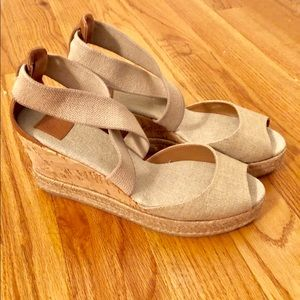 Tory Burch gold wedge shoes